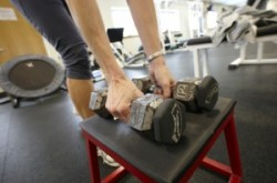 womens-hands-picking-up-weights-300x199